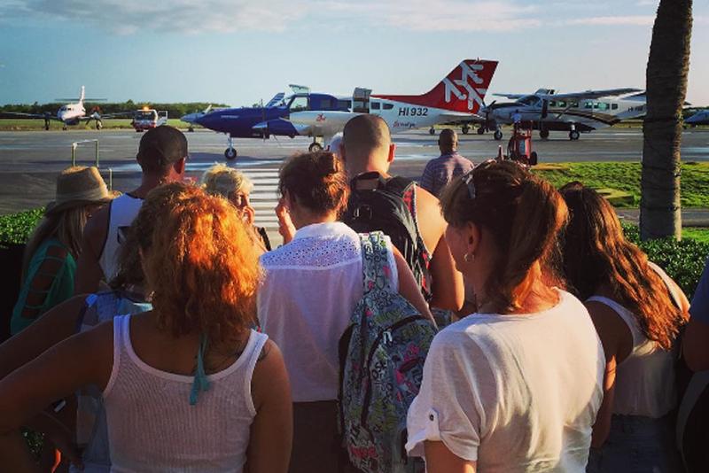 Passenger boarding airplane reefjet punta cana